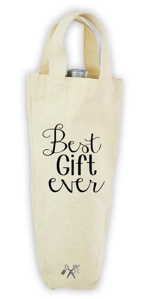 Cotton/poly canvas wine bottle tote with webbed handles. Heat transfer black vinyl professionally applied. Text - Best gift ever.