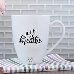 17oz white porcelain mug with black, permanent, premium vinyl applied. Text - just breathe in script