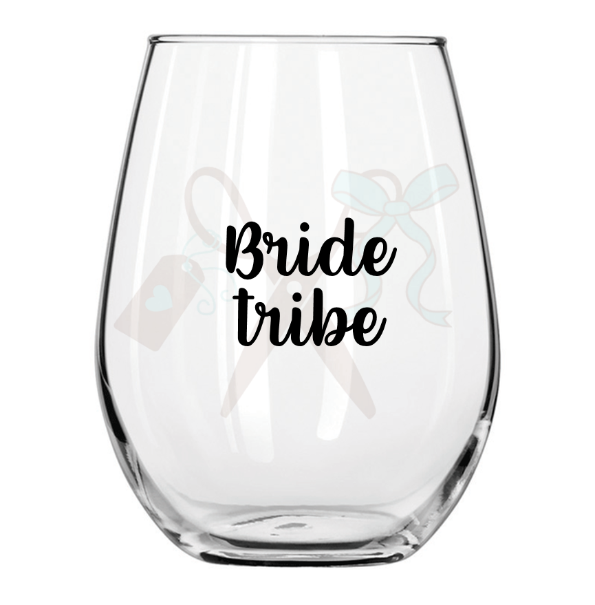 21oz stemless wineglass with black premium, permanent, vinyl application. Text - bride tribe in script font.