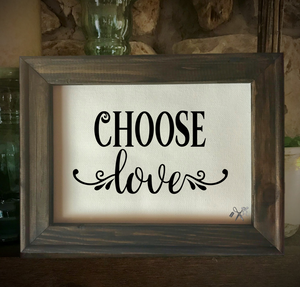 8x10 reverse canvas. Frame is dark walnut stained. Heat transfer vinyl in black, professionally applied with script text - choose love with decorative motif.