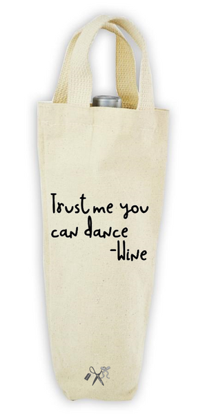Cotton/poly canvas wine bottle tote with webbed handles. Heat transfer black vinyl professionally applied. Text - Trust me you can dance. Wine
