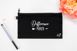 5x8 black cotton makeup bag. White text - difference maker.