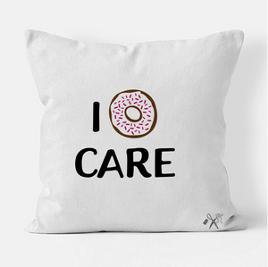 16x16 square, cotton, white pillow cover. Heat transfer vinyl professionally applied. Text - I sprinkled donut icon care
