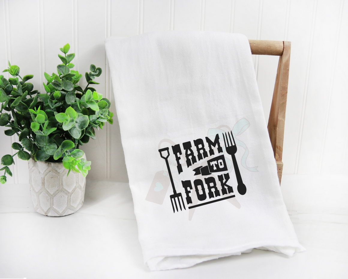 Cotton white towel with text Farm to Fork with a kitchen and pitch fork on either side in black