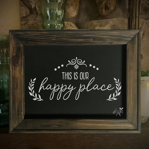 8x10 reverse black canvas. Frame is dark walnut stained. Heat transfer vinyl in white, professionally applied with text - this is our happy place with decorative laurel motifs.