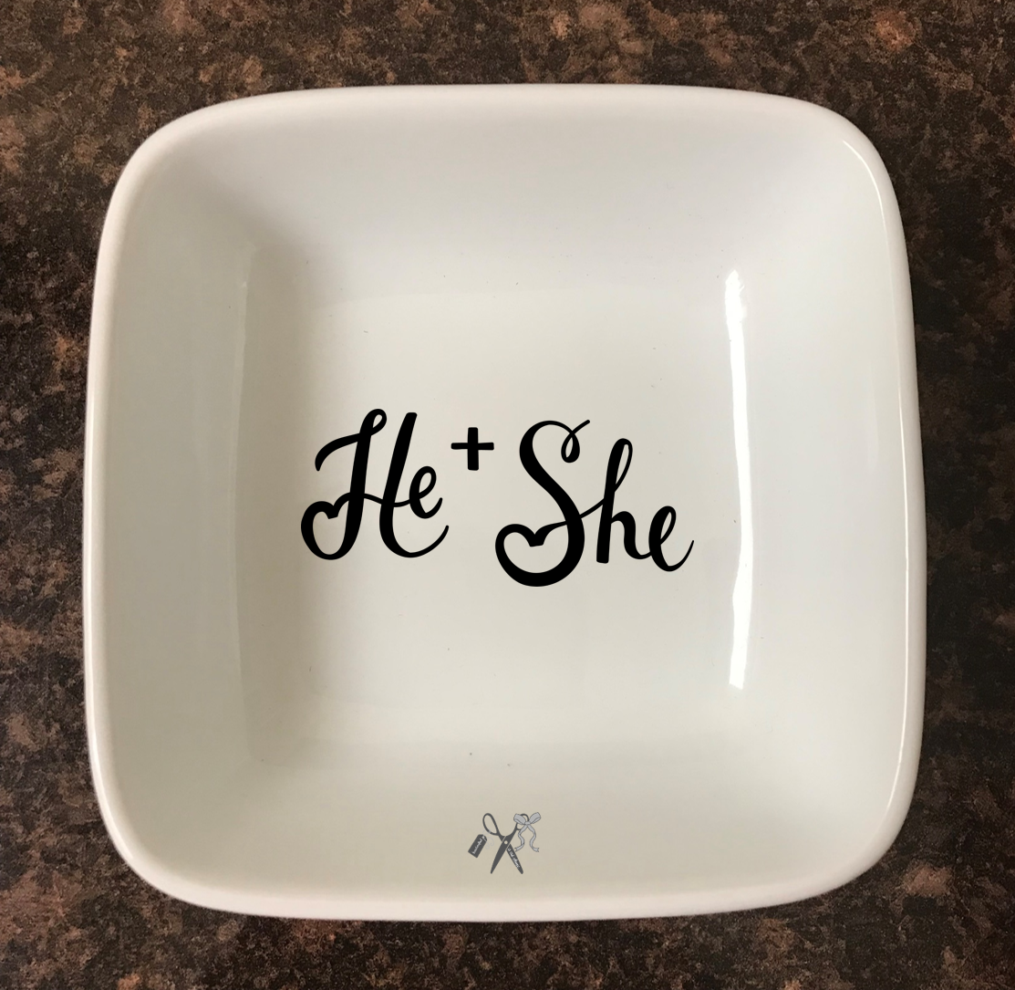 4x4 porcelain square trinket dish. Premium, permanent vinyl applied. Text - he + she. Choice of color and text combo.