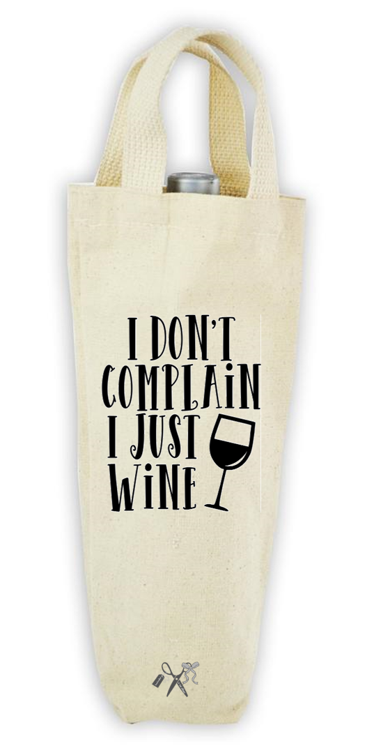 Cotton/poly canvas wine bottle tote with webbed handles. Heat transfer black vinyl professionally applied. Text - I don't complain. I just wine. Includes image of wine glass.