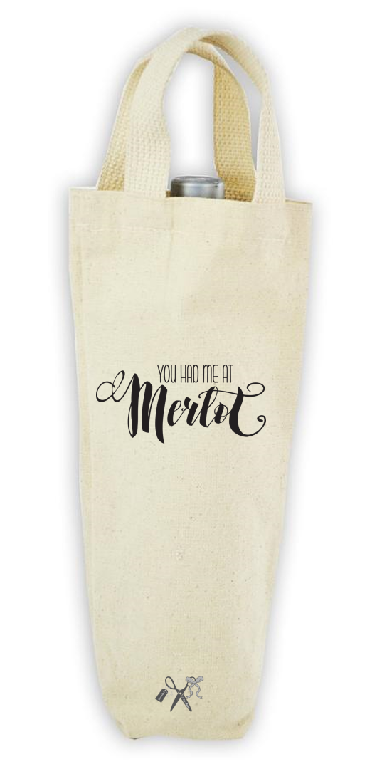 Cotton/poly canvas wine bottle tote with webbed handles. Heat transfer black vinyl professionally applied. Text - You had me at merlot.