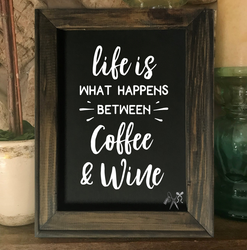 8x10 reverse black canvas. Frame is dark walnut stained. Heat transfer vinyl in white, professionally applied with text - life is what happens between coffee & wine.