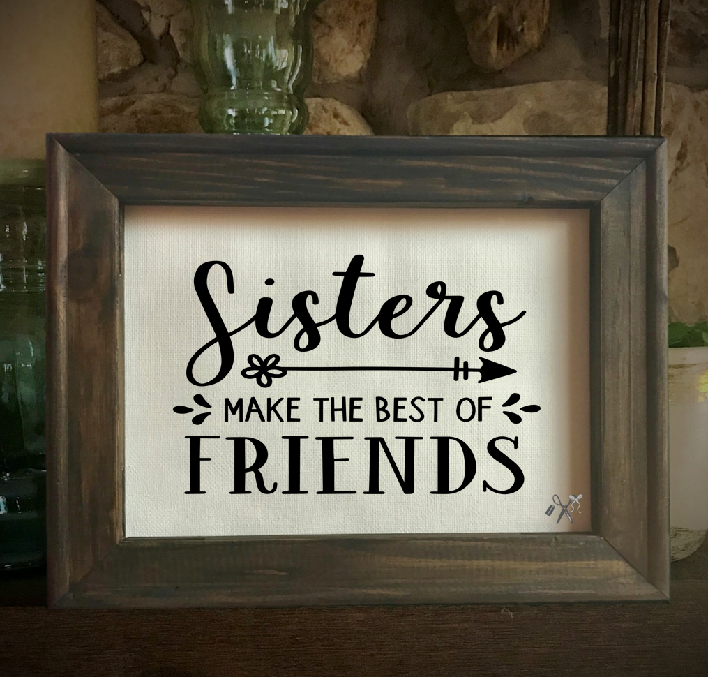 8x10 reverse canvas. Frame is dark walnut stained. Heat transfer vinyl in black, professionally applied with text - sisters make the best of friends.