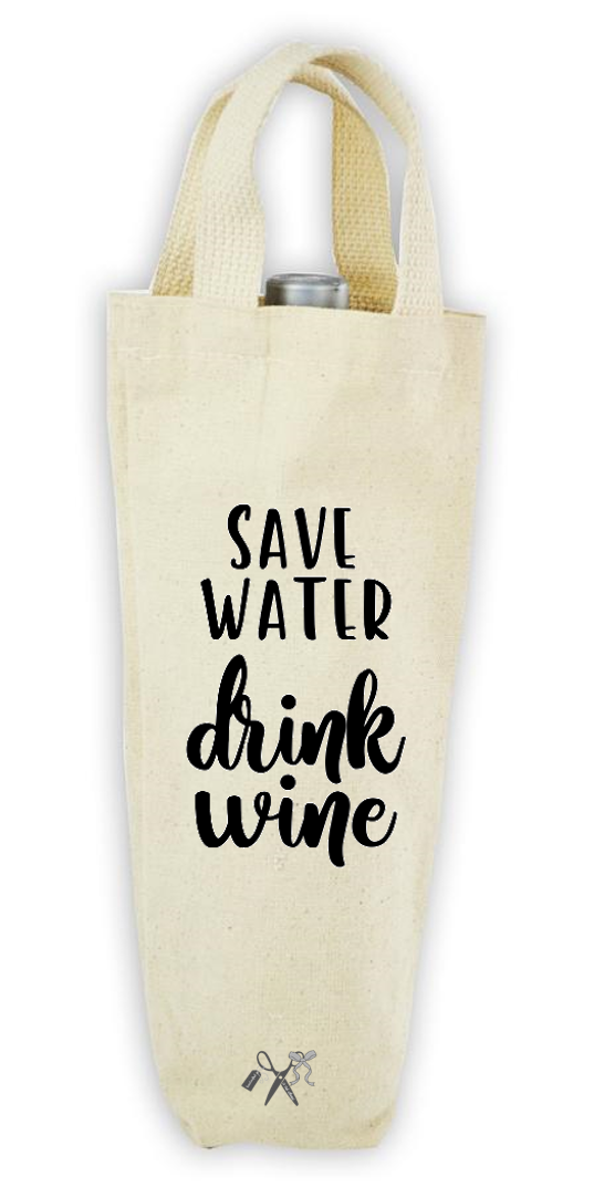 Cotton/poly canvas wine bottle tote with webbed handles. Heat transfer black vinyl professionally applied. Text - Save water drink wine.