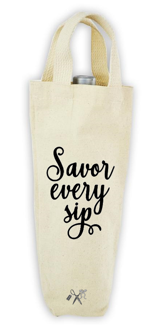 Cotton/poly canvas wine bottle tote with webbed handles. Heat transfer black vinyl professionally applied. Text - Savor every sip.