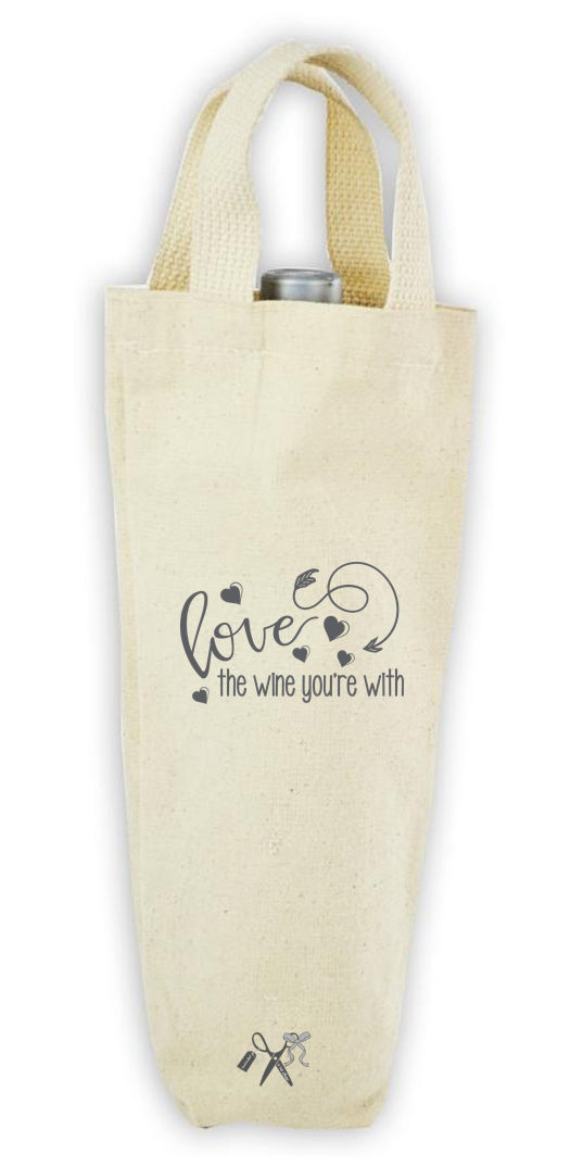 Cotton/poly canvas wine bottle tote with webbed handles. Heat transfer gray vinyl professionally applied. Text - Love the wine you're with.
