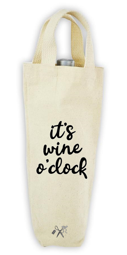 Cotton/poly canvas wine bottle tote with webbed handles. Heat transfer black vinyl professionally applied. Text - It's wine o'clock