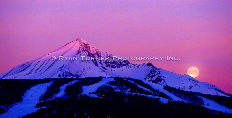 Moon Sets as the Sun Rises on Lone Peak