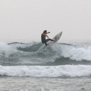 jonny fenner surfing in cornwall off the lip sponsored surfer by eco clothing brand