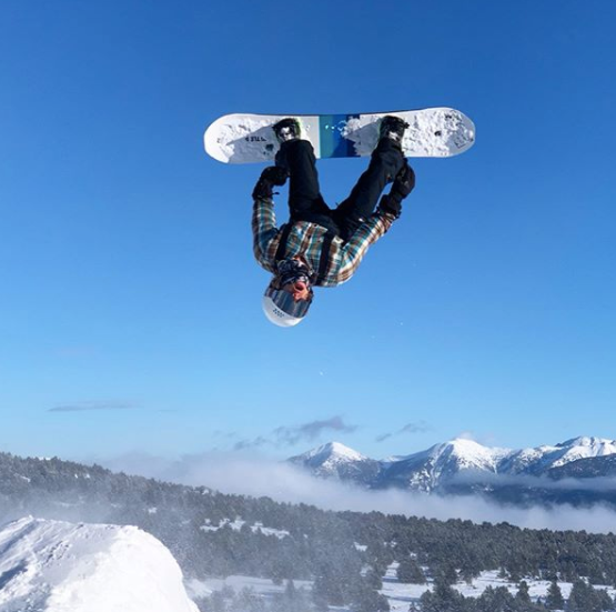 baptiste snowboarder backflip areal jump blue sky pyrenees eco environment enjoying nature sustainable clothing respecting climate change