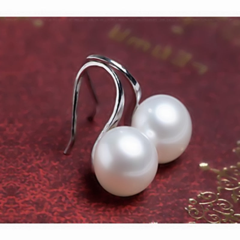 white/simulated pearl earrings