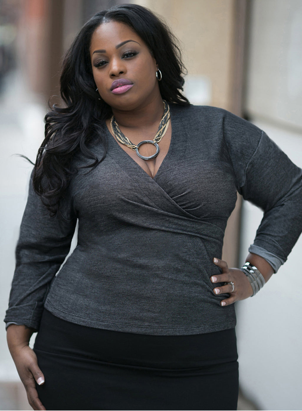 CURVY PLUS SIZE WRAP TOP WITH SLEEVES IN BLACK STRETCH DENIM JERSEY