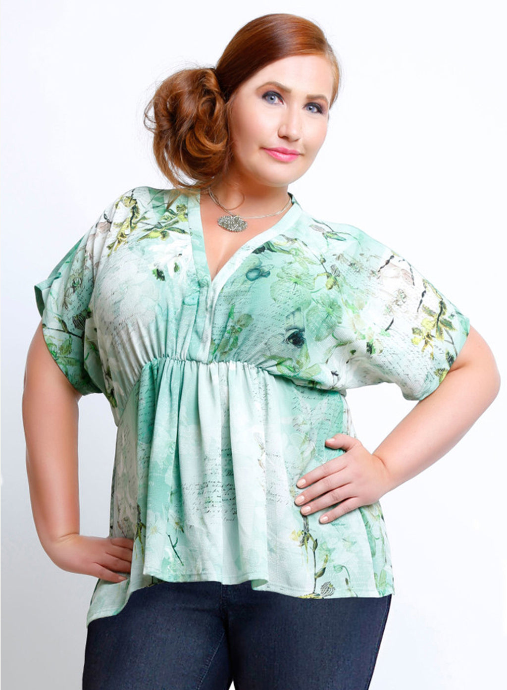 curvy women's plus size blouse with empire waist in green floral