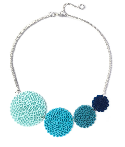 Blue circles necklace - in light to dark shades of blue and grey.