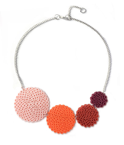 Muted orange circles necklace - in shades of orange, salmon and brown.