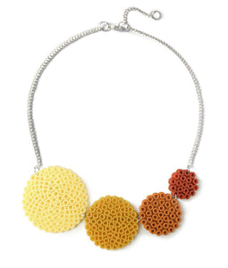 Ochre circles necklace - in muted shades of ochre and burnt orange.