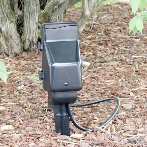 SG Home Outdoor Power Strip Wi-Fi Hidden Camera in the dirt outside