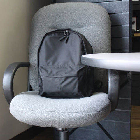 xtreme life plus backpack hidden camera on an office chair