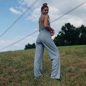 Gray jumpsuit with an open back- Unbothered