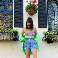 A lightweight, purple and green, sheer, tie-dye cropped tank top.