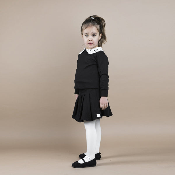 THE JERSEY PLEATED SKIRT - ALL BLACK - The Tiny Universe Skirts
