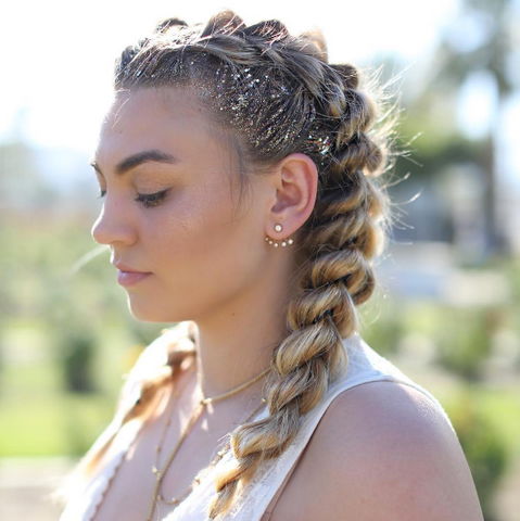 Girl with festival hair braids and glitter roots