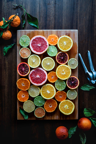 Tray of grapefruit, lemon, limes and other citrus fruits to represent vitamin C, for Ivy Leaf Skincare blog