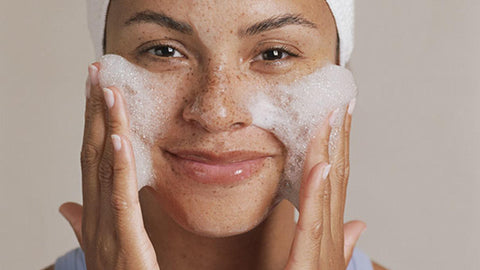 Woman washing face, for Ivy Leaf Skincare