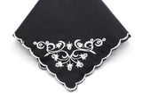 black handkerchief with white scalloped edge and white embroidered corner