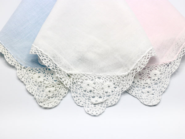 Reproduction vintage handkerchiefs in pastel blue, pink, and white with beautiful crochet corner