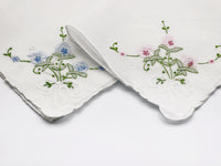 white handkerchief with pastel floral embroidered corner