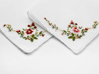 white handkerchief with floral embroidered corner