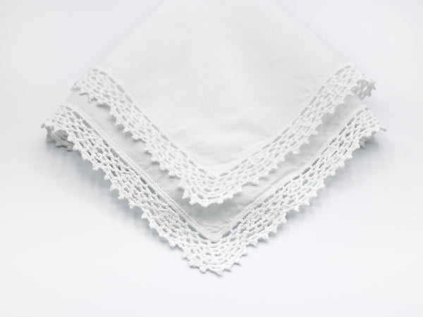 reproduction vintage handkerchief with crochet border on all sides.