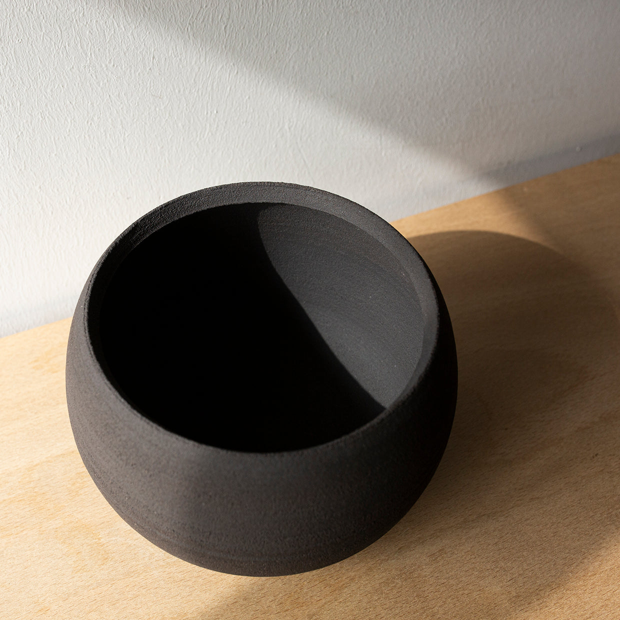 Unglazed rounded black offering bowl
