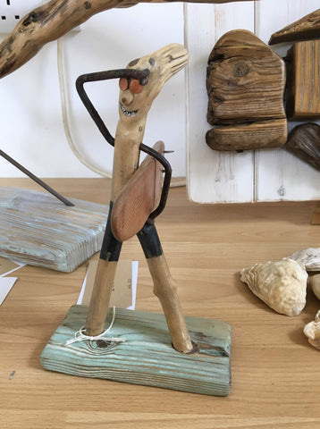 Surfer dude wooden sculpture