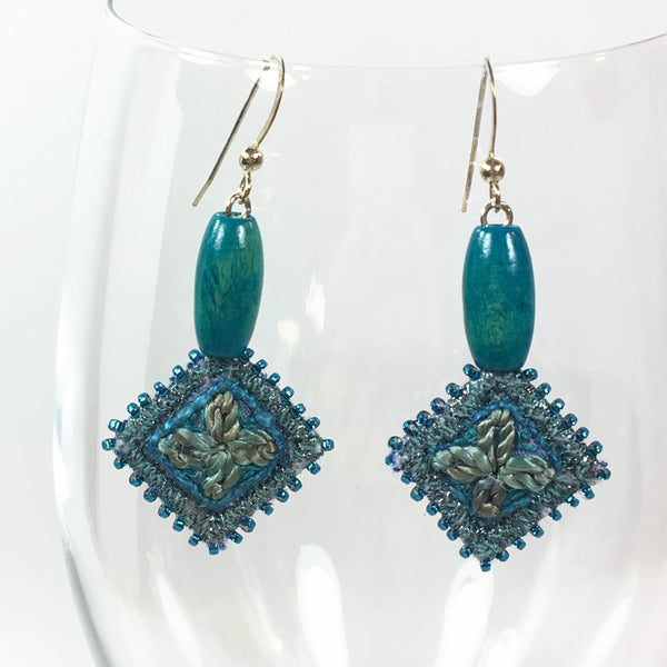 Embroidered blue dangle drop earrings