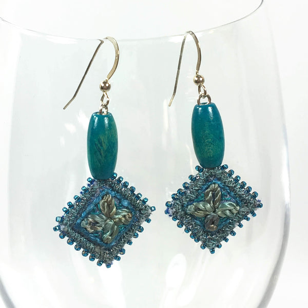 blue hand stitched flower earrings