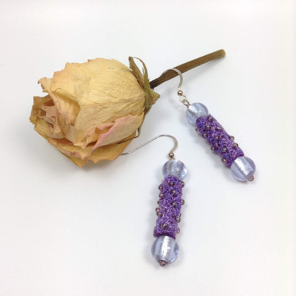 Artisan dangle drop earrings with mauve fibre art tube beads by textile artist Tors Duce