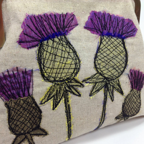 Embroidered Scottish thistles by textile artist Tors Duce