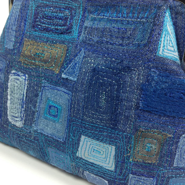Detail of free machine embroidery of denim, cotton, silk and velvet