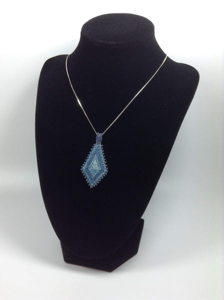 Embroidered and beaded denim blue pendant necklace