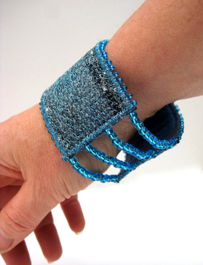 Artisan textile art jewellery with elasticated blue beads
