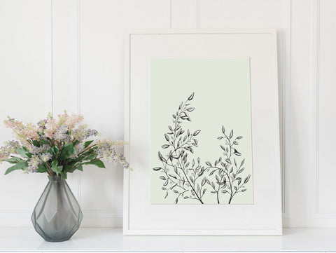 Framed print of a greenery illustration in a sage green color